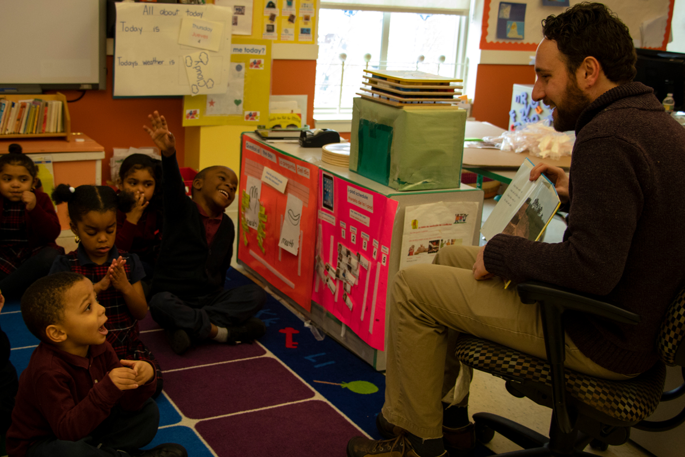 Photo of doctoral work study intern student reading a ELRA preschool student