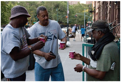 Photo of Harlem residents holding coffees