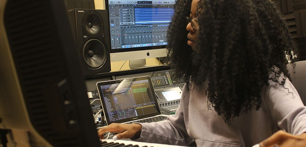 Photo of student working in the music tech lab