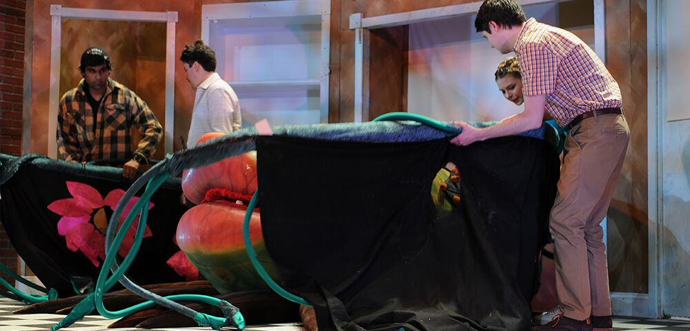 photo of students working on set design for Lil Shop of Horrors