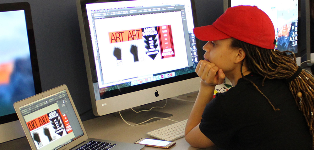Photo of Graphic Design Student at computer