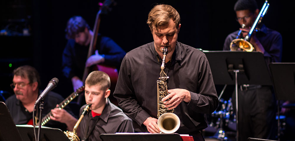 photo of student playing sax in concert