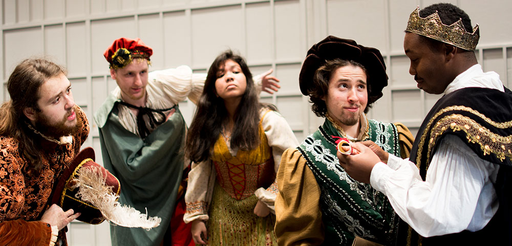 Students wearing costumes in a Theater Production