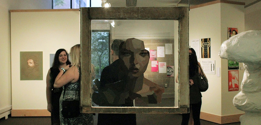 Photo of artwork on display at a student exhibition