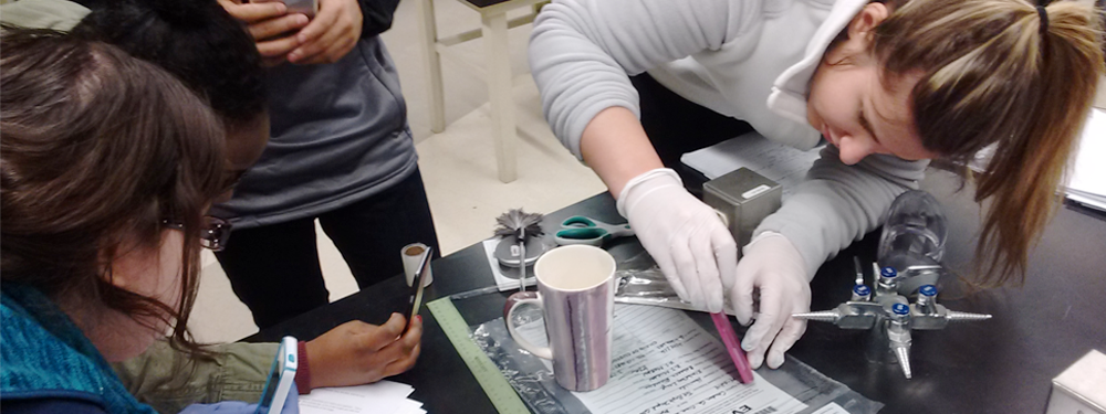 students learning how to study fingerprints on a mug